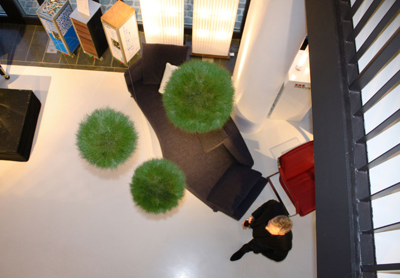 Grass balls as design solution in stairway reception area